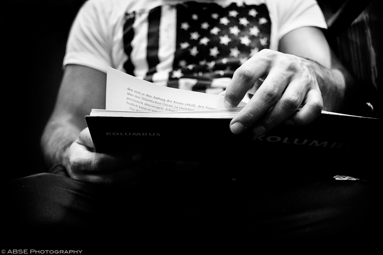 IMAGE: http://blog.absephotography.com/wp-content/uploads/2017/09/hands-project-munich-2017-september-black-and-white-ubahn-transport-candide-kolombus-usa-flag-1.jpg