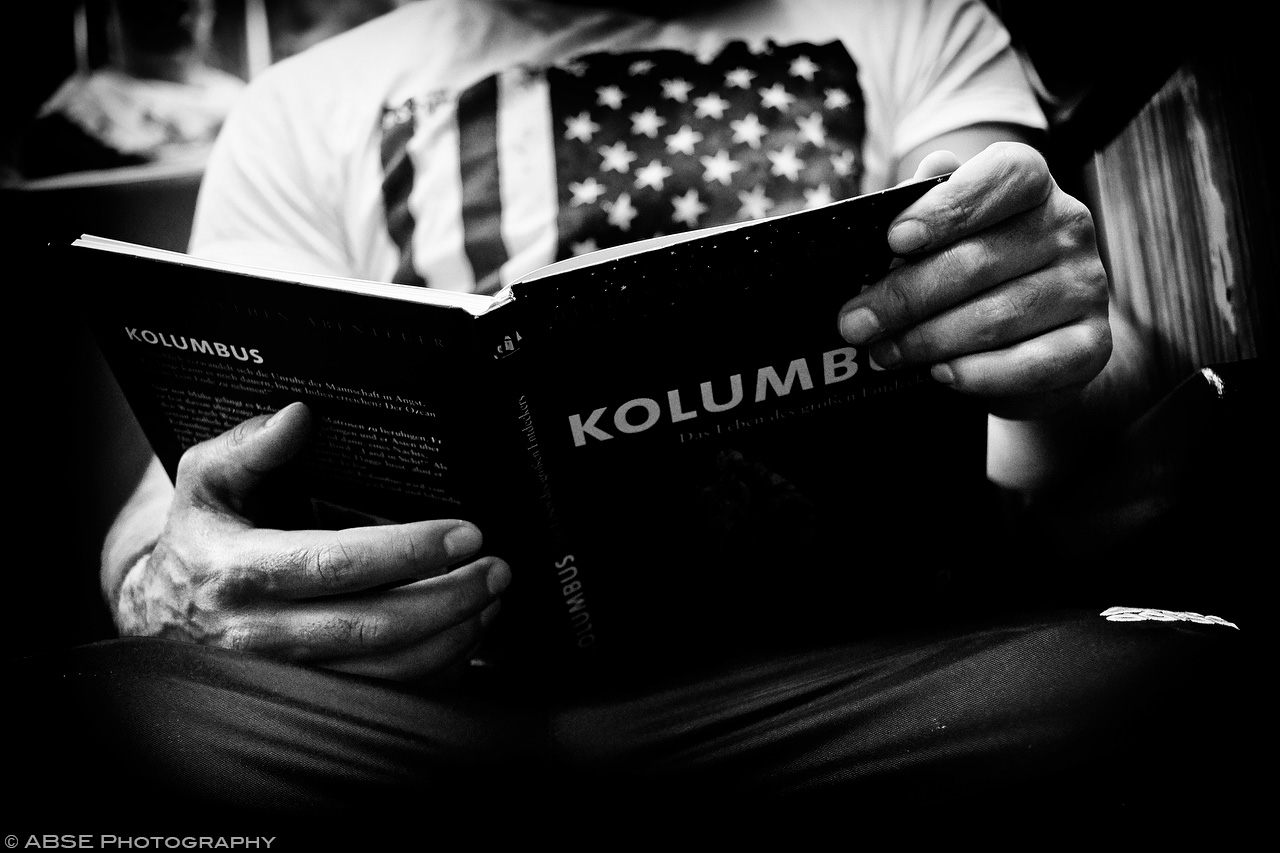 IMAGE: http://blog.absephotography.com/wp-content/uploads/2017/09/hands-project-munich-2017-september-black-and-white-ubahn-transport-candide-kolombus-usa-flag-2.jpg